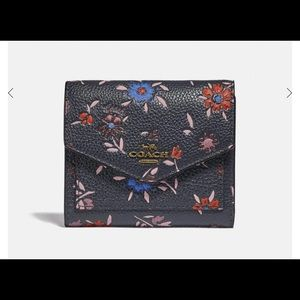 Coach wallet NWT with wildflower print